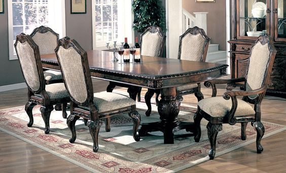 This Saint Charles 7pc Dining Room Set with elaborate carvings and
