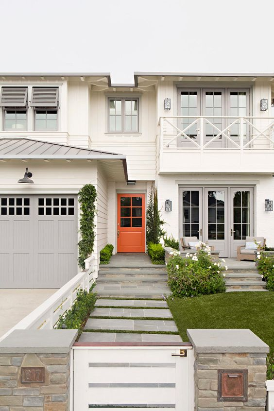 Orange Front Door. Orange Front Door. Beach house with off white siding, light gray trim and garage door. Front door is painted in an orange color. #orange #frontdoor Matt Morris Development