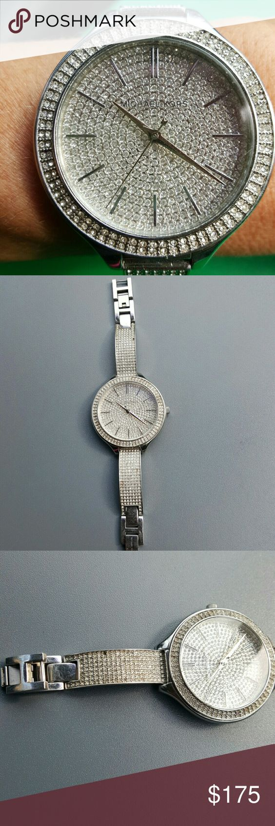 MICHAEL KORS RUNWAY SILVER BLING BIG FACE WATCH This is an authentic Michael Kors Runway silvertone bling rhinestone big face ladies watch. It is pre owned but still in excellent condition. It is missing rhinestone please see picture 3. Nothing that's really noticeable I just did want to mention it Michael Kors Accessories Watches