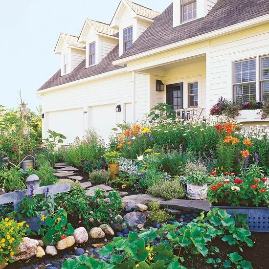 This flower-filled front yard garden incorporates lots of herbs and vegetables, too -- so harvesting fresh, homegrown produce is a breeze: http://www.bhg.com/gardening/landscaping-projects/landscape-basics/front-yard-flower-power/?socsrc=bhgpin032514edibleplants&page=12: