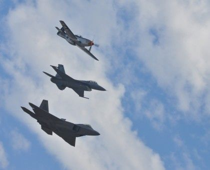 Three Generations of Fighters -- a P-51 Mustang, F-16 Fighting Falcon and F-22 Raptor fly in formation at MCAS Miramar, San Diego, California, on October 2, 2010.  Photo Credit:  Lance Cpl. Jamean Berry, USMC