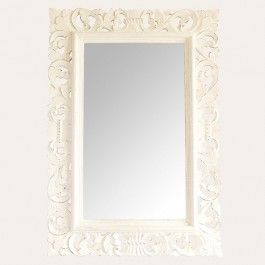 Delicately carved swirl motifs spring forth from a dramatic rectangle frame with a gently distressed cream finish, creating an enchanting border for whatever - or whoever - is seen in the reflection.