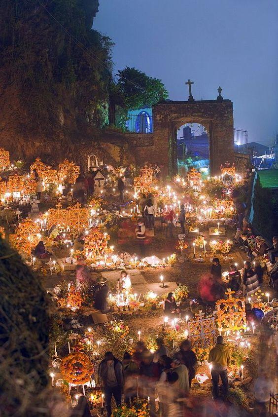A candle lit cemetery, Dia de Muertos (Day of the Dead) festival in a cemetery on Isla Janitzio, Lago de Patzcuaro, Michoacan state, Mexico  #méxico #visitmexico #michoacán #mexicotravel