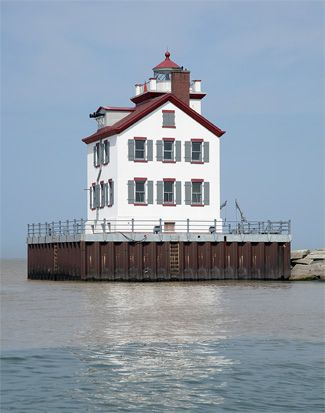 Lorain, Ohio, saw its first navigation light in the form of a lantern hanging from a pole at the mouth of the Black River during the early 1800s. In 1837, a cylindrical brick tower capped with a lantern room was built at the outer end of the pier that extended from the west bank of the Black River. The light was fueled by lard oil, and eventually by kerosene. Though unassuming, the station shone brightly enough to be noticed by Charles Dickens as he sailed from Sandusky to Cleveland in 1841.