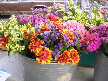Like the idea of the metal pot to put our flowers in since it will be an outdoor summer wedding