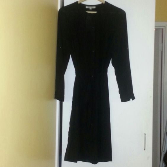 DRESS This shirt dress has slits on  both sides can be worn over some thing or with just pants. sleeves can be worn up or down comes with a belt. Has tags  couldn't wear it tag says XL but inside label says small. 100% polyester. Dresses Midi