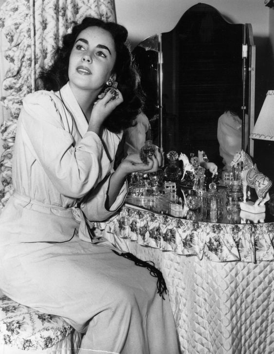Elizabeth Taylor at her dressing table