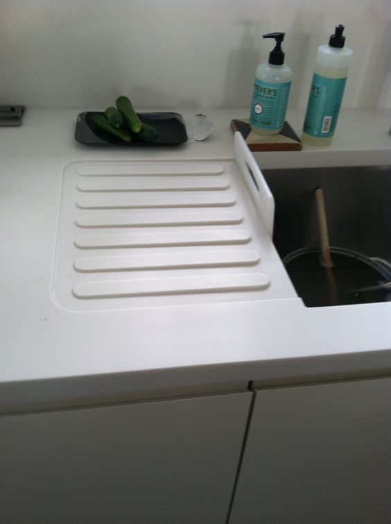Drainboard Integrated Into Corian Countertop Kitchen