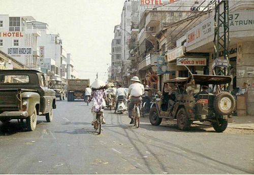 The jeep on the right carries two military police through the streets of Saigon, 1966.