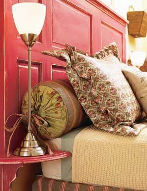 Old door headboard. Love the little lamp shelf too!