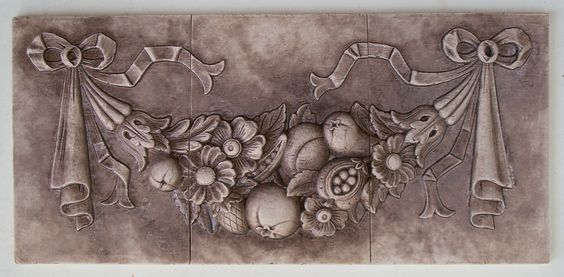 Andersen Ceramics - 512-921-4771 - creator of high relief single and multi-tile decorative ceramic tile inserts and tile murals.  Inspired by decorative carvings on antique French furniture.