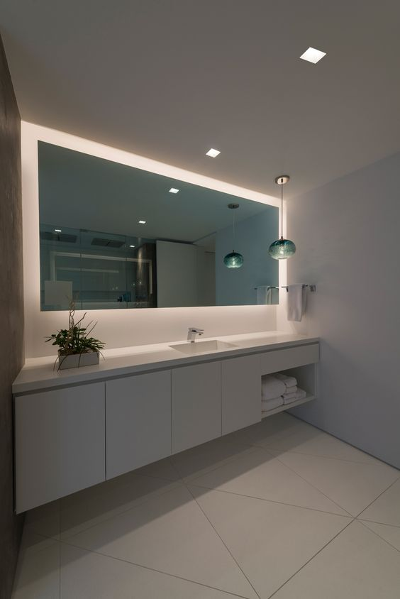 The truly trimless appearance of recessed square LEDs allow for a serene environment while adding to the modern architecture of a room | Modern LED Lighting For The Bathroom | Aurora Dual Square Edge 3.3 - by Pure Lighting