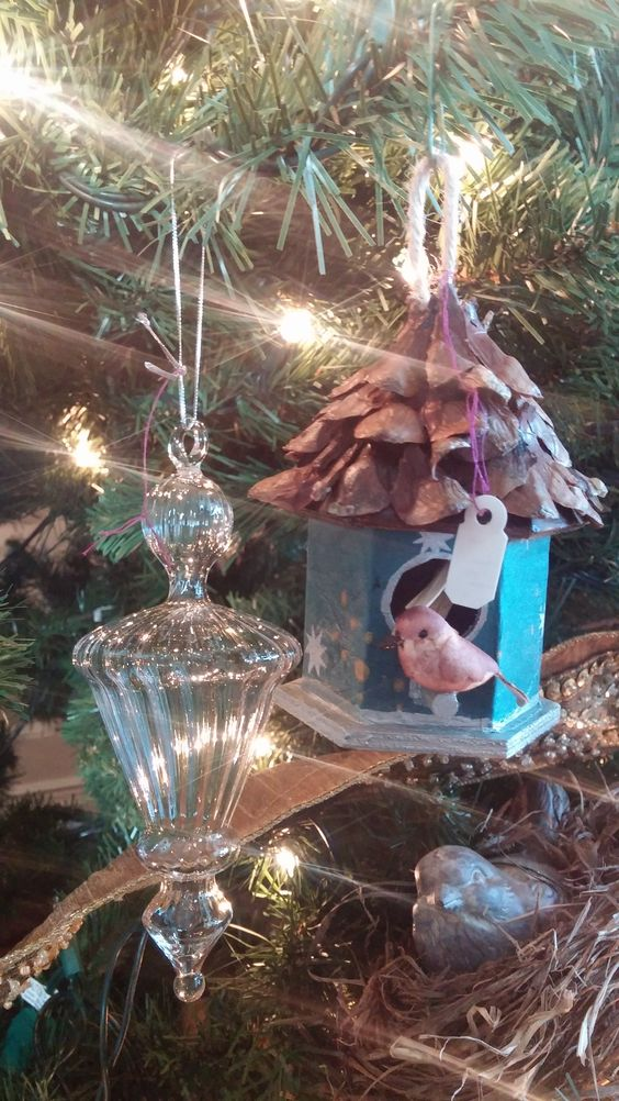 Various bird themed ornaments and baubles on one of our River Farm holiday trees.