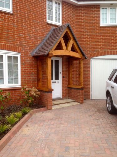 Oak porch doorway wooden porch canopy entrance self for Front porch roof kits