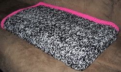 Zebra Print Throw , If you're ready to take a walk on the wild side, then this crochet pattern is perfect for you. Use two strands at one to create a thick afghan that's full of texture. The hot pink border turns this Zebra Print Throw into something that's truly unique!