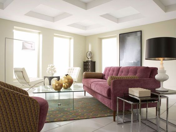 A posh, contemporary living room furnished by CORT. Features a soft velvet couch for a calming splash of purple against glass-top tables. | cort.com Genevieve with Glass-on-Glass Living Room