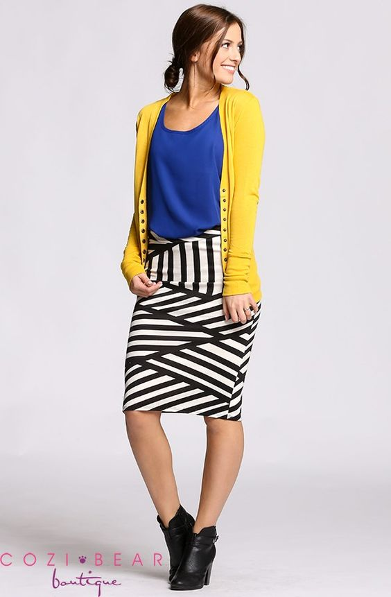 Love the yellow cardigan over the blue top. It reminds me of summer!
