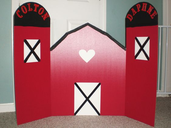 Barn backdrop for the food table! Made with red tri-fold poster board, black paint, white paper, and some cardstock letters.