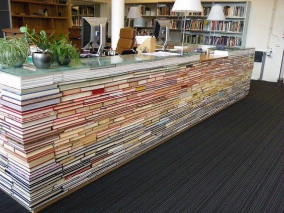Information, repurposed.   Stacked with irony and precision, dusty old books leave their lonely shelf to serve a new purpose as the 'library information desk.'   http://bit.ly/bks_ — at by architecture students at Delft University of Technology, Netherlands.