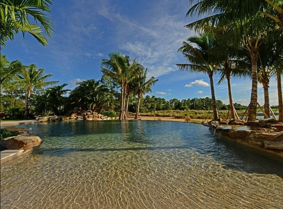 Beach-entry pool with natural lagoon coloring...