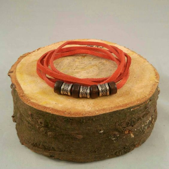 Red leather wrap bracelet with metallic looking pony beads and wooden beads.