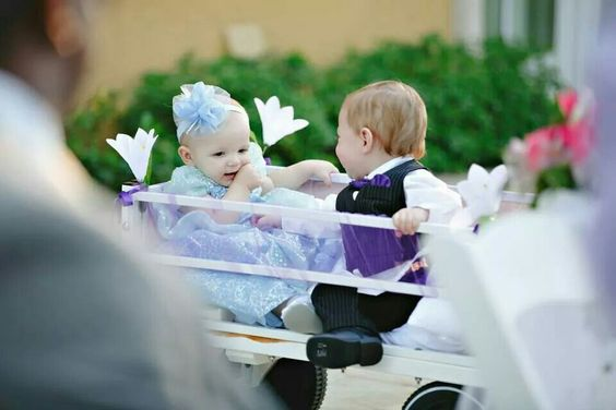 Flower girls as princesses fpr a disney themed wedding. And a wagon for those flower girls and ring bearers who can't yet walk down the aisle.