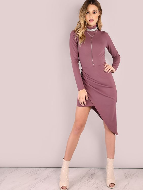 "Look as dashing as a lavender field in this eye catching wear. Featuring a mock neckline, sleeved arms, a bodycon fit, asymmetrical look with crepe detailing, back zip closure and an underlining mini skirt. Dress measures 46.5"" in. from top to bottom hem. Compliment with gold drop earrings and nude heels. #sexy #MakeMeChic #style #fashion #newarrivals #fall16"