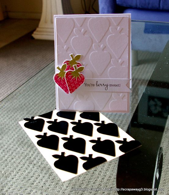 Diecut strawberries out of packaging. Then stick them on a scrap cardstock. This became the embossing plate. Run cardstock over it using cuttlebug and Voila! cardstock embossed with strawberries on them