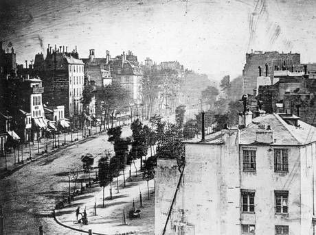 The first ever photograph of a human. Daguerre's image of Boulevard du Temple, Paris, 3rd arrondissement, in 1838. The man having his shoes shined can be seen in the bottom left