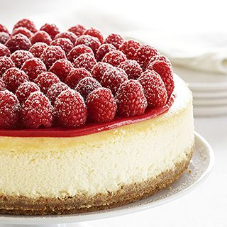 This is a spectacular party dessert with a terrific make-ahead feature simply because cheesecake always get better after 2 or 3 days in the fridge. All you have to do on serving day is add the topping and raspberries.: