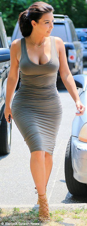 Kim Kardashian out for family lunch, July 2014. Taking the plunge: The low-scooping neckline of the dress allowed Kim to display her ample...