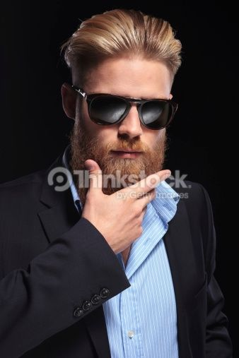 Stock-Foto : bearded business man with hand at chin