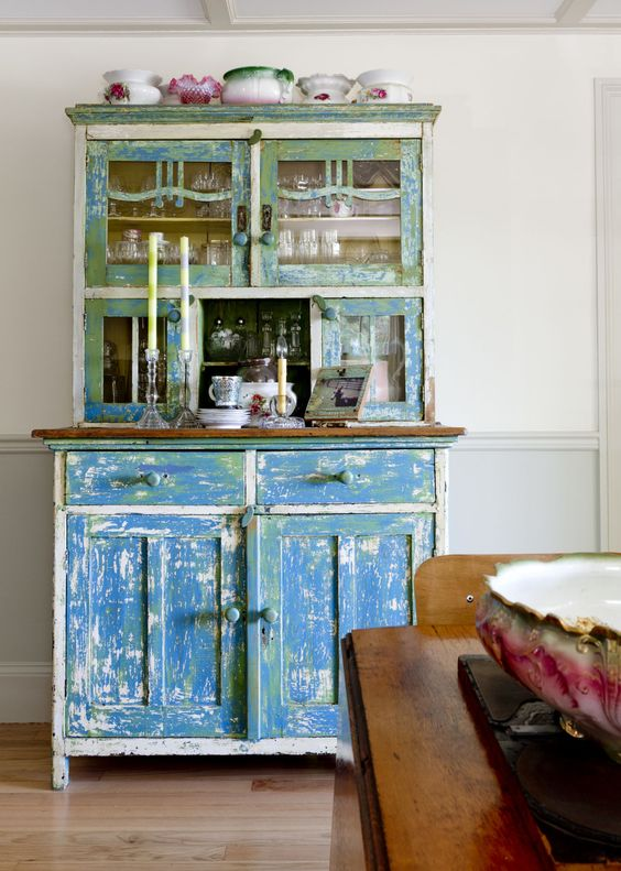 Even with stunning dishes stored inside, this shabby chic cabinet manages to be the star of the display.    - CountryLiving.com