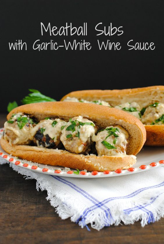 Meatball Subs with Garlic-White Wine Sauce - Perfect for tailgating and game-watching parties! Can be kept warm in a slow cooker until ready to serve. #SundaySupper   foxeslovelemons.com