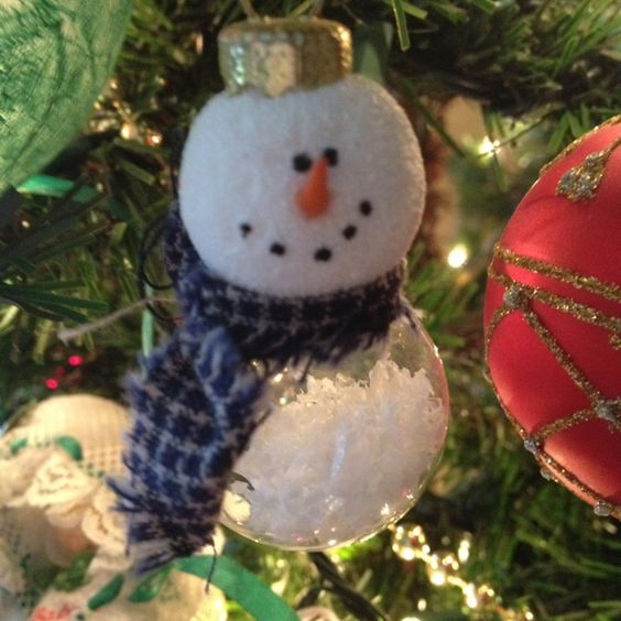 Another snowman ornament! So easy, I did these a few years back. Fill glass ornament with snow, secure small styrofoam head and coat head with snow texture paste (I use Aleene's) secure the metal holder in the top of the head. Use tip of toothpick painted orange for nose, black paint for eyes and mouth and add fabric for scarf! Everyone loves getting this one as a gift!