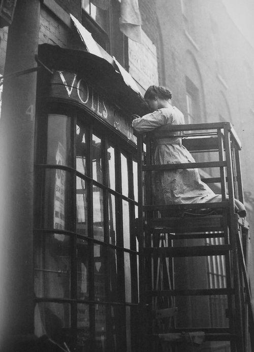 English suffragette Estelle Sylvia Pankhurst at work on the facia of the Women's Social Defence League shop, London, 1912.