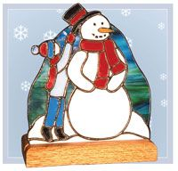 """A 7-1/4"""" x 9"""" free-form stained glass snowman fan light. Details are added with copper foil overlay. The design can be adapted for a large or small fanbase. This project is constructed using the copper foil technique."""