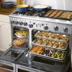 Brand: THERMADOR, Model: PRG484ECG    I love how it's design is very much like I Love Lucy's stove, but with a griddle instead of a counter!