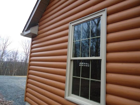 Close up of the side of timbermill vinyl simulated cedar for E log siding