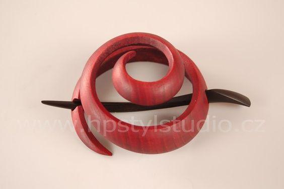 Wooden hair clip / spring / to hold a lot of hair into a knot and  firmly it attach to the head.    The shape of the clip is designed to be flexible. Hair is  pushed inwards and hairstyle is reinforced by assembling  skewer. There is no need for rubber bands or pins. Hairstyle  with clasp holds perfectly. It is lightweight, strong and  flexible.