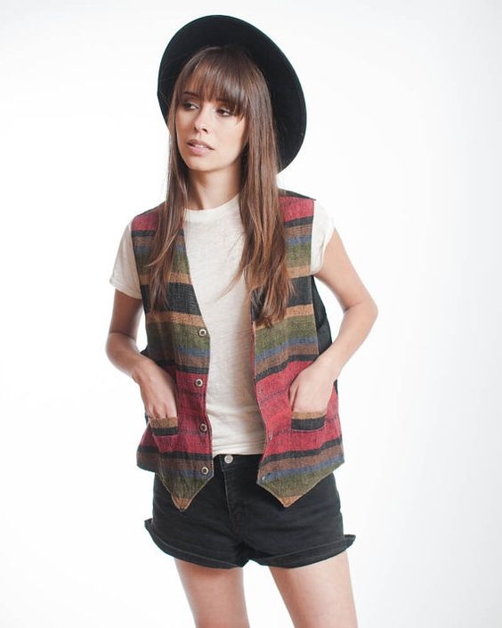 I had a vest like this! I, too, wore it with shorts, but my shorts were faded and ripped and I wore them with black tights and a pair of Chucks! Yes I know I was a true fashion plate hahaha