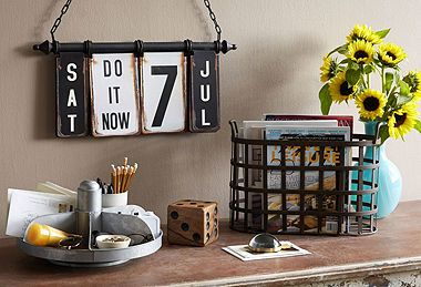 This calendar would be easy to replicate with chipboard & ring clips. Cute, right?