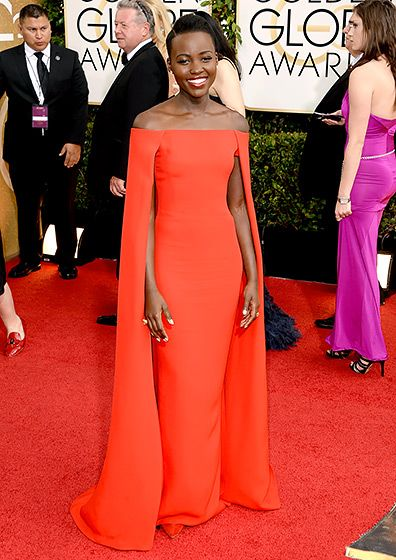 Lupita Nyong'o stuns in this caped Ralph Lauren gown at the 2014 Golden Globes