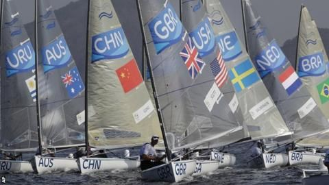 Great Britain's Giles Scott moved into the overall lead in the men's Finn sailing event at the Rio Olympics.