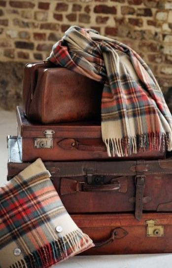 Vintage luggage and Tartan, but look at that pillow. It looks like a scarf was wrapped around it. It has me thinking!