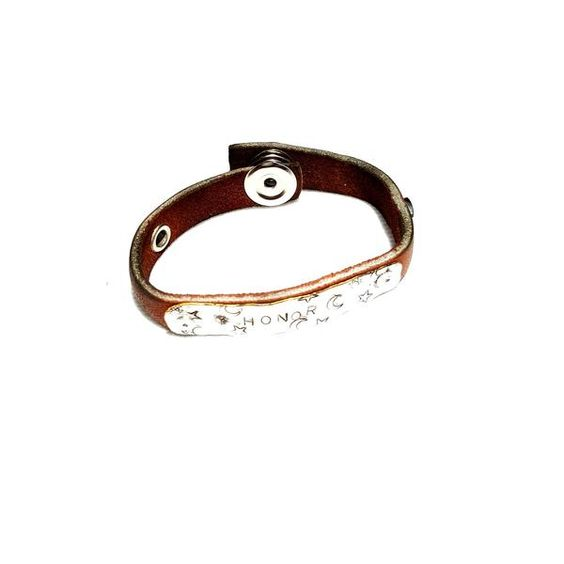 Leather bracelet has rugged style that shows off a down to earth vibe. The word Honor proudly displayed on a mirror finish metal plate, makes it a perfect gift.