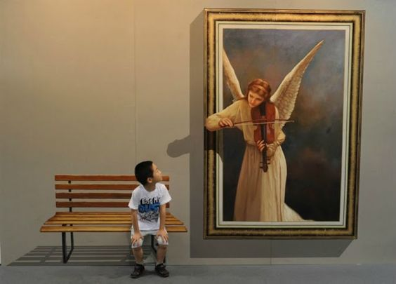 3D Painting at the 2012 Magic Art Special Exhibition-A boy poses with a 3D painting at the 2012 Magic Art Special Exhibition in Hangzhou, China. In one of the few art exhibitions where photography and touch are actively encouraged, visitors are able to interact with the paintings by touching, sitting on them and even sticking their heads into the artworks.