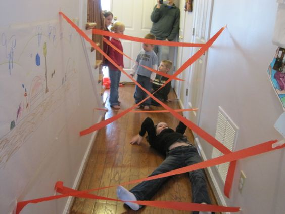 Masking tape + hallway = rainy day spy game. The boys will LOVE. Bring on the rain!