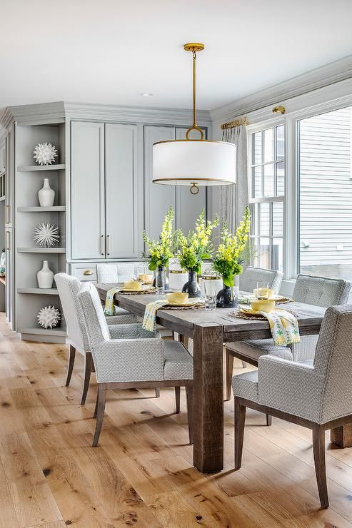 Gray Pattern Dining Chairs Surround A Dark Brown Dining Table Lit