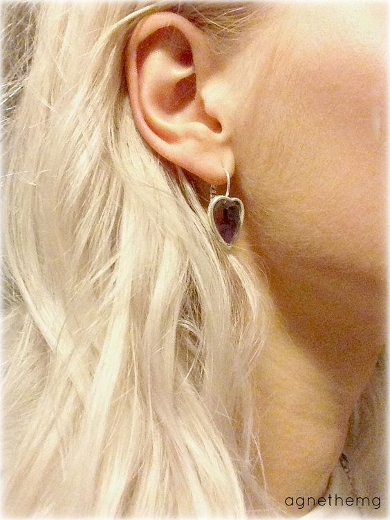 platinum blond hair and silver earrings.